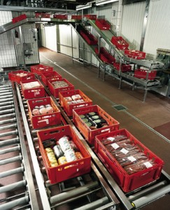 Conveyer belt in meat packing plant with protective flooring below depicted.