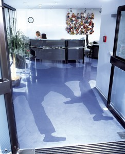 Modern colored concrete design with shadows imprinted in floor.