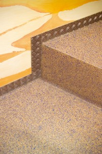 Close up of stair flooring system with bight colors.