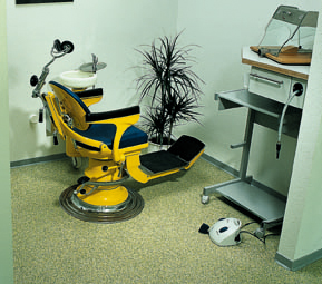 A dentist chair sits center of a hygiene critical flooring system newly installed.