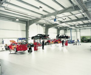 Large working automotive repair facility with a beautiful white high gloss commercial epoxy flooring.