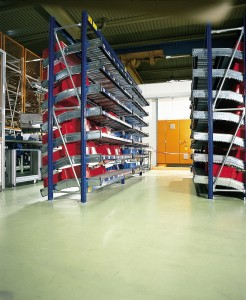 Large warehouse with storage racks and a monolithic flooring depicted.