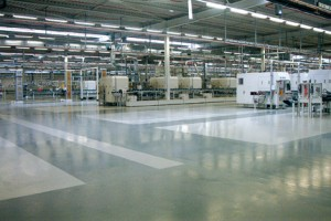 Large factory seal coating flooring system shines beneath the light.