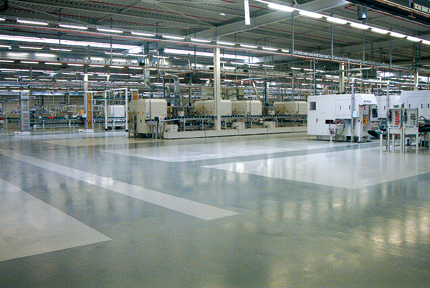 Large Factory Seal Coating Flooring System Shines Beneath The Light