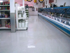 Front display area of warehouse benefits from the new acrylic flooring adhesive with a brighter display room.