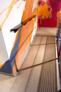 Best flooring type will enhance a space such as this office walk ramp depicted.