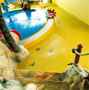 Concrete floor colors bring replicated pond to life in this child play area.