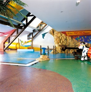 Concrete floor colors bring to life interior play area for children.