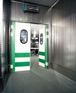 Freezer room floors visible thru open freezer door of commercial resaurant.
