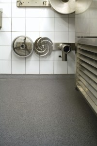 Laboratory work room proudly displays its new chemical resistant concrete flooring.