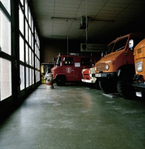 Industrial garage houses numerous vehicles showing the quality in the concrete floor strength within.