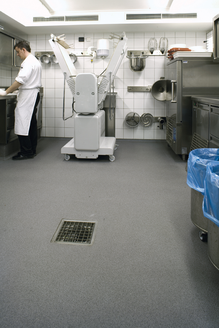 A Working Restaurant Kitchen Bustles With Life Over A Newly Installed Seamless Flooring System