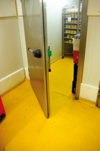 A newly restored floor protects this walk in cooler from degradation.