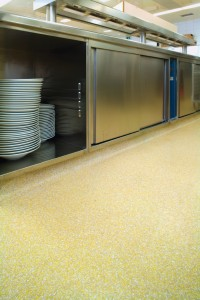 A self leveling floor underlayment saved this kitchen floor from needing costly removal of old tiles.