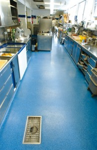 A commercial kitchen displays its new flooring for concrete slab in a beautiful blue tone.