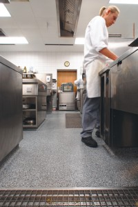 Commercial food grade flooring protects against the chef's spillage as he prepares his prep table.
