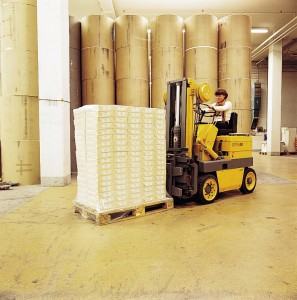 Concrete slabs endure forklift abuse with the help of a new industrial floor coating in this large warehouse.