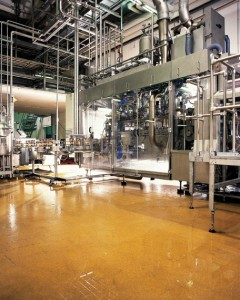 A mustard hue floor coating material lightens this production factory concrete floor system.