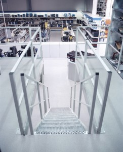 Steps with rails incorporate a floor protect product in the new flooring surrounding.