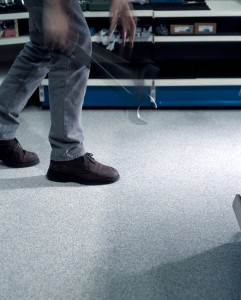 Close up of mans feet as he walks across protective floor products.