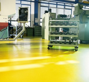 A body shop concrete sealer non flammable flooring system gleams in the sunlight.