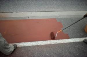 A paint application coats this aircraft hangar floor.