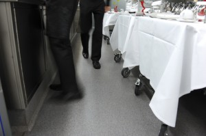 A clear floor coating for no slip resistance protects these waiters and waitresses from fall harm.