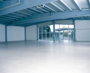 A new warehouse floor system proudly displays the floor leveling liquid compound that restored its once damaged surface.