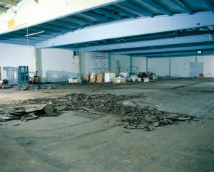 A severly damaged warehouse floor slab get prepared for a top coat liquid floor leveling compound.