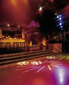 A night club dance floor lights up with liquid floor tiles.
