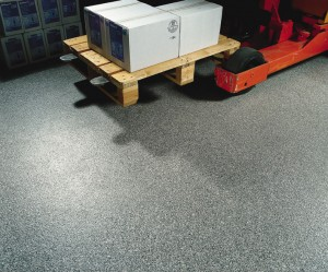 A pallet jack moves materials across a non skid floor finish additive with ease.