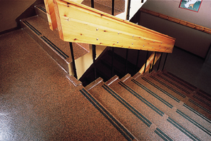 Commercial stairway shines with a new nonskid finish flooring additives top coat.