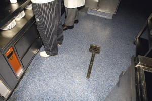 Resurfaced kitchen flooring coats the once old tile floor.