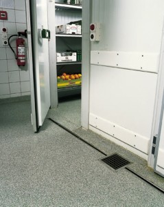 Freezers walked in flooring seamlessly transitions this space from kitchen area to freezer floor area.