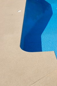 Outdoor pool decks shine with brightness with new concrete coatings.