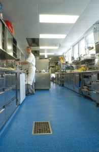 Cement coating products protect this floor while cooks begin their morning prep work.