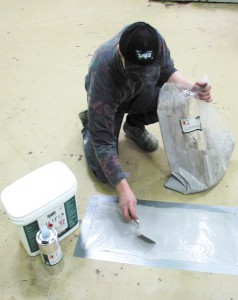 A professional epoxy concrete repair is visibly underway by this professional installer.