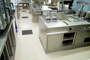 A commercial kitchen floor closes house for the night knowing that the newly installed voc free floor finish will keep things nice and neat for the morning shift.