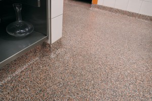 A tiled wall meets our superb coating product designed for cement in this close up view.