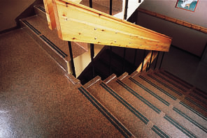 Industrial stairing over concrete recieves new top coating protection.