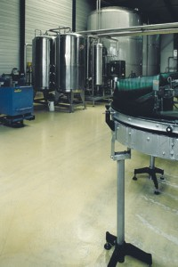 A chemically resistant tan floor coating protects surrounding area from chemical holding tanks.