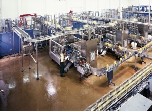 Large chemical producing assembly line floor system shines bright with resistant top coating.