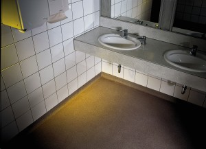A slip resisting bathroom surface with tiled porcelain walls keeps this bathroom safe and clean.