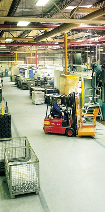 Forklift Driving On Strong Industrial Floor.