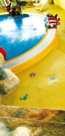 Yellow Architectural Flooring Around An Indoor Pool.