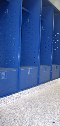 Premium Commercial Flooring With Flakes To Match The Blue Locker-room.