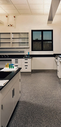 Laboratory With Chemicals On The Counter And Dependable Flooring Below.