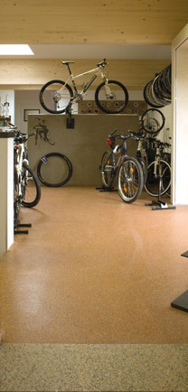 Bicycle Shop With Bikes Resting On Flooring Designed To Last.