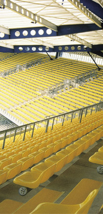 Stadium Seating With The Best Industrial Floors Colored To Match The Yellow Chairs.