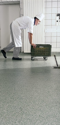 Chef Pushing Cart Over Tough Floor Coatings In Kitchen.